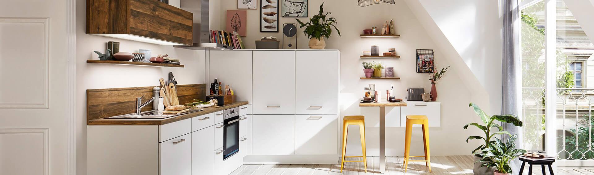 küchenzeile l-form mit Tisch und mit Elektrogeräte nobilia